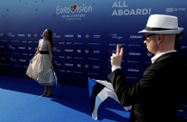 Contestant Elina Nechayeva of Estonia poses on the blue carpet during the opening party for Eurovision Song Contest at the Maat museum in Lisbon