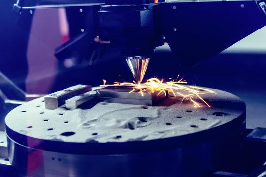 3D metal printer produces a steel part.