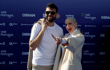 Contestants Madame Monsieur of France pose on the blue carpet during the opening party for Eurovision Song Contest at the Maat museum in Lisbon
