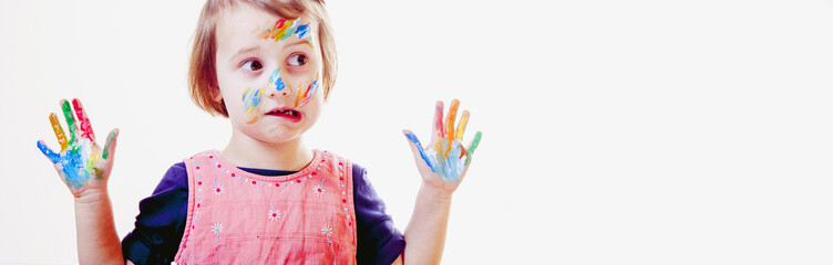 Humorous portrait of little cute girl with children's makeup and painting colorful hands. (people, childhood, art concept)