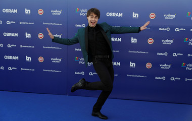 Contestant Alexander Rybak of Norway poses on the blue carpet during the opening party for the Eurovision Song Contest at the Maat museum in Lisbon