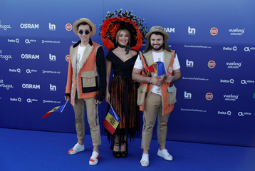 Contestants DoReDoS of Moldova pose on the blue carpet during the opening party for the Eurovision Song Contest at the Maat museum in Lisbon, Portugal