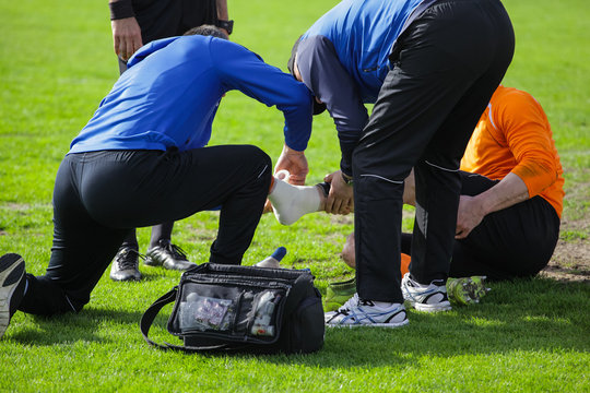 medical assistance to a football player