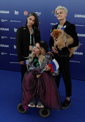 Contestant Julia Samoylova of Russia poses on the blue carpet during the opening party for the Eurovision Song Contest at the Maat museum in Lisbon