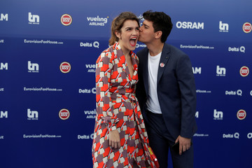 Contestants Amaia and Alfred of Spain kiss on the blue carpet during the opening party for the Eurovision Song Contest at the Maat museum in Lisbon