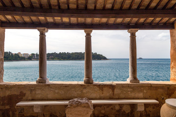 View through an antique building of Rovinj town on Adriatic sea, one of major tourist attractions at Istria in Croatia, Europe.