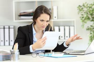 Confused office worker reading documents