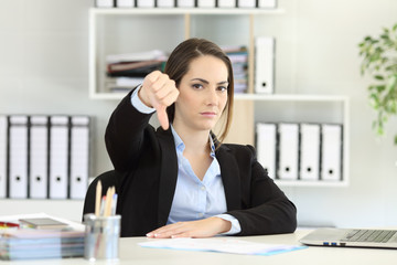 Businesswoman denying with thumbs down