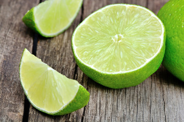 Fresh lime on rustic wood table