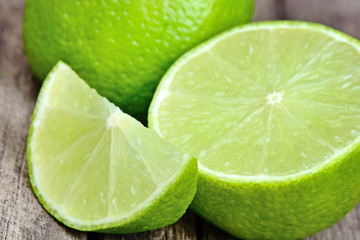 Close up of fresh lime green on a rustic table