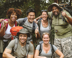 Group of diverse friends trekking together