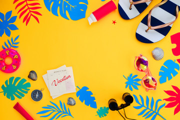 Header with traveling essentials flat lay on a vibrant yellow background. Summer vacation accessories, sunglasses, flip-flops, sunscreen, tiny swim ring, shells with feminine blue and pink palette.