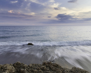 seascape with beautiful clouds in the background taken with a long exposure