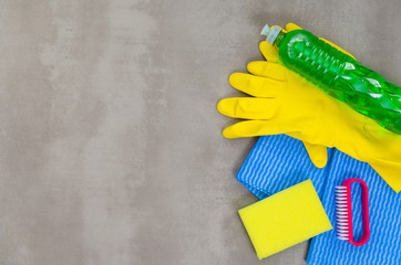 Great concept of cleaning, various products used in cleaning on gray background.