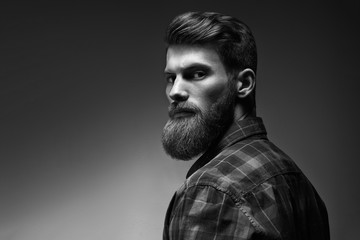 Black and white photo of bearded stylish businessman Handsome confident perfect hairstyle man...
