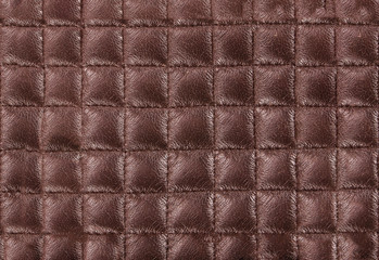 brown leather texture colose-up with linear stiches