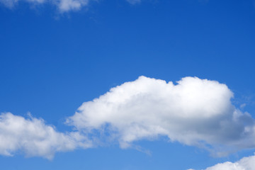 Blue sky background with clouds .