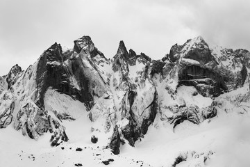 Detail of the Sciero group in the Rhaetian Alps in Switzerland. Black and white fine art mountain winter