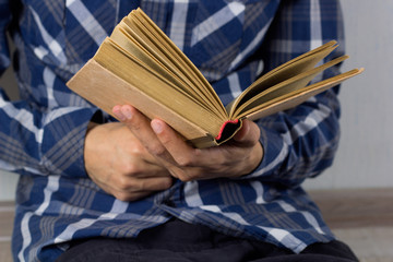 closeup man's hands with open book