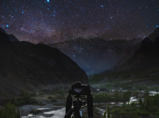 Taking night photography by dslr camera, Night sky full of stars and milky way with silhouette mountains valley