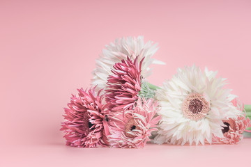 Pretty pastel flowers bunch on pink background.