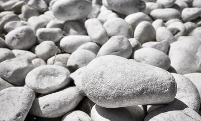 Acrylic Prints Stones in Sand Close up picture of naturally polished white pebbles, selective focus.