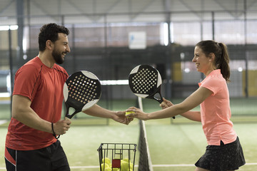 paddle tennis couple players ready for  class
