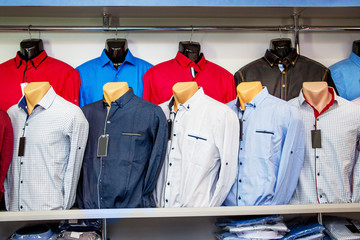 Men's shirts on the mannequins in  store. Men's clothing sale_