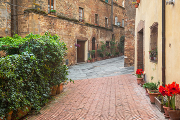 Rainy and sunny wet streets in Pienza.