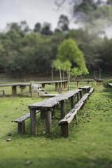 Outdoor wooden furniture in field