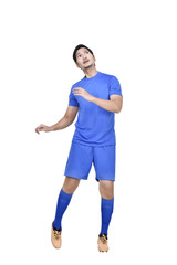 Attractive asian male soccer player heading the ball