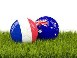France vs Australia. Soccer concept. Footballs with flags on green grass