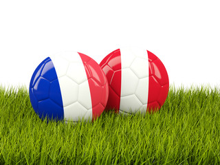 France vs Peru. Soccer concept. Footballs with flags on green grass
