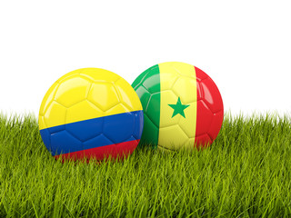 Colombia vs Senegal. Soccer concept. Footballs with flags on green grass