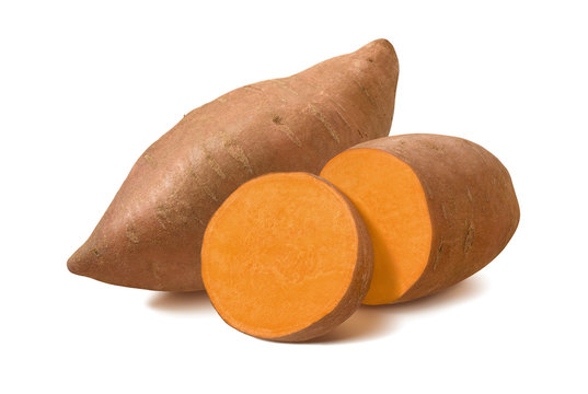 Whole sweet potato and slices isolated on white background.