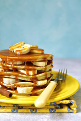 Banana pancakes with caramel for a breakfast.