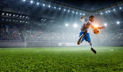 Soccer player at stadium. Mixed media