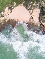 Wall Mural - Overhead shot of beautiful sandy beach and ocean.