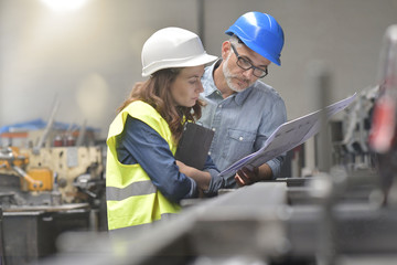 Metal industry manager and engineer meeting in factory Wall mural