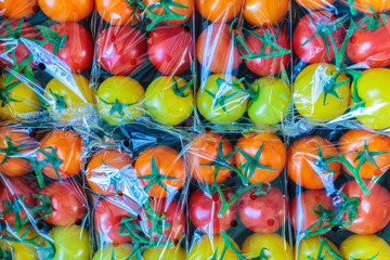 Display of fresh plastic wrapped cherry tomatoes
