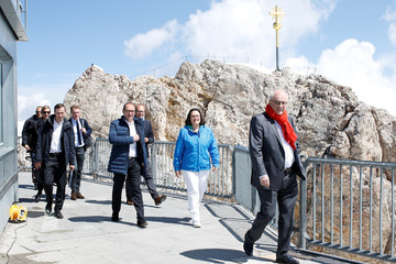 Party leaders arrive in front of the summit cross on top of the mountain Zugspitze, prior to their meeting near Garmisch-Partenkirchen