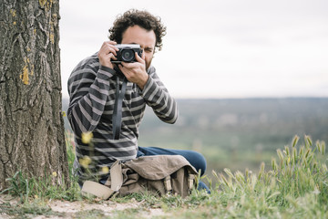 Man photojournalist poses with his photo camera