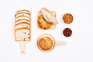 Homemade breads or bun, bakery ingredients, flour, eggs almond nuts, hazelnuts on white background, , Bakery background frame, Cooking breakfast concept. Flat lay, Top view.