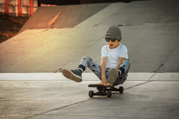 Little boy enjoy skateboarding