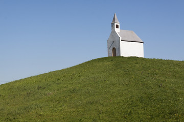 White chapel on a green hill