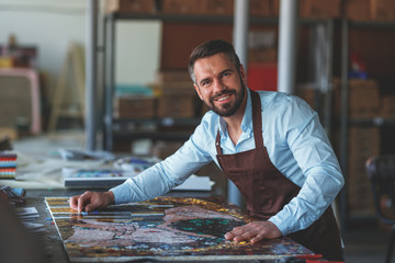 Smiling master in a creative workshop