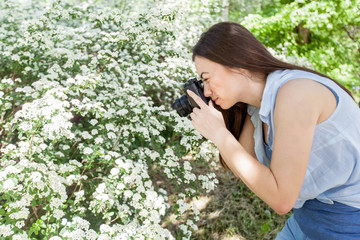 Female photographed nature with retro old camera