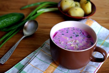Cold Lithuanian soup with beets, greens and eggs. Served with boiled potatoes