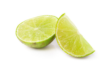 Juicy slice of lime isolated on a white background.