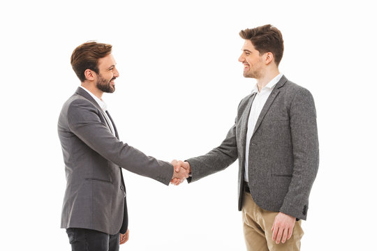 Portrait of a two satisfied business men shaking hands